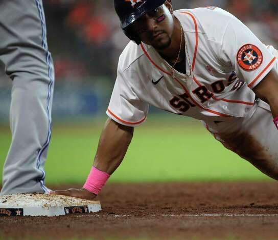 Houston Astros shortstop Robel Garcia (9) slides back to first base on a pick-off attempt during the third inning of an MLB game Sunday, May 9, 2021, at Minute Maid Park in Houston. Photo: Jon Shapley, Staff Photographer / © 2021 Houston Chronicle