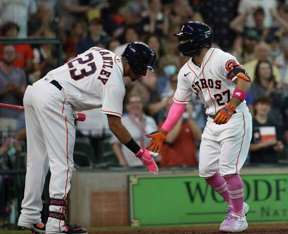 Houston Astros second baseman Jose Altuve (27) celebrates with left fielder Michael Brantley (23) after he hit a home run during the fourth inning of an MLB game Sunday, May 9, 2021, at Minute Maid Park in Houston. Photo: Jon Shapley, Staff Photographer / © 2021 Houston Chronicle
