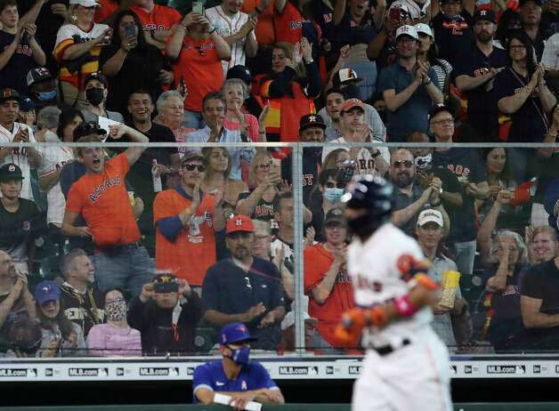 Fans cheer as Houston Astros second baseman Jose Altuve (27) rounds the bases after hitting a home run during the fourth inning of an MLB game Sunday, May 9, 2021, at Minute Maid Park in Houston. Photo: Jon Shapley, Staff Photographer / © 2021 Houston Chronicle