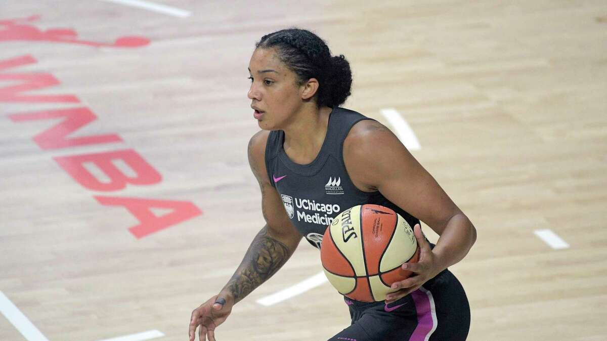Chicago Sky forward Gabby Williams brings the ball up the court during the first half of a WNBA basketball game against the New York Liberty, Tuesday, Aug. 25, 2020, in Bradenton, Fla. (AP Photo/Phelan M. Ebenhack)