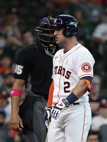 Houston Astros third baseman Alex Bregman (2) exchanges words with home base umpire Jeremie Rehak after he struck out during the sixth inning of an MLB game Sunday, May 9, 2021, at Minute Maid Park in Houston. Photo: Jon Shapley, Staff Photographer / © 2021 Houston Chronicle