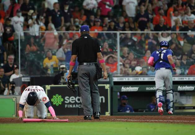 Houston Astros catcher Martin Maldonado (15) waits to get up after he was tagged out at home during the fifth inning of an MLB game Sunday, May 9, 2021, at Minute Maid Park in Houston. Photo: Jon Shapley, Staff Photographer / © 2021 Houston Chronicle