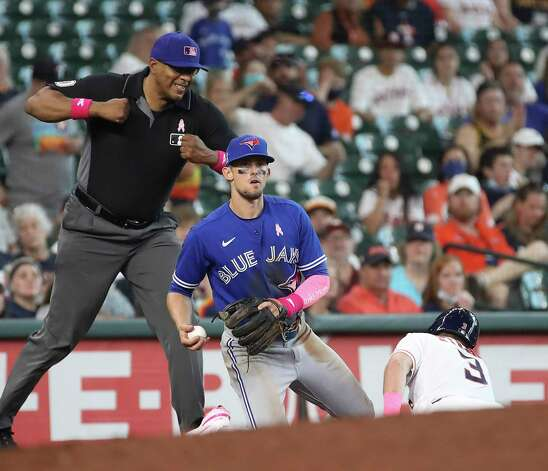 Toronto Blue Jays third baseman Cavan Biggio (8) tags Houston Astros center fielder Myles Straw (3) out at third on a steal attempt during the fifth inning of an MLB game Sunday, May 9, 2021, at Minute Maid Park in Houston. Photo: Jon Shapley, Staff Photographer / © 2021 Houston Chronicle