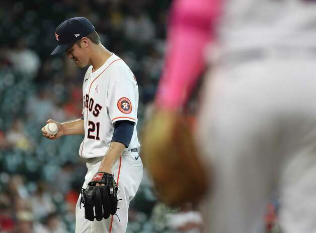 Houston Astros starting pitcher Zack Greinke (21) waits as manager Dusty Baker walks to the mound during the fifth inning of an MLB game Sunday, May 9, 2021, at Minute Maid Park in Houston. Photo: Jon Shapley, Staff Photographer / © 2021 Houston Chronicle
