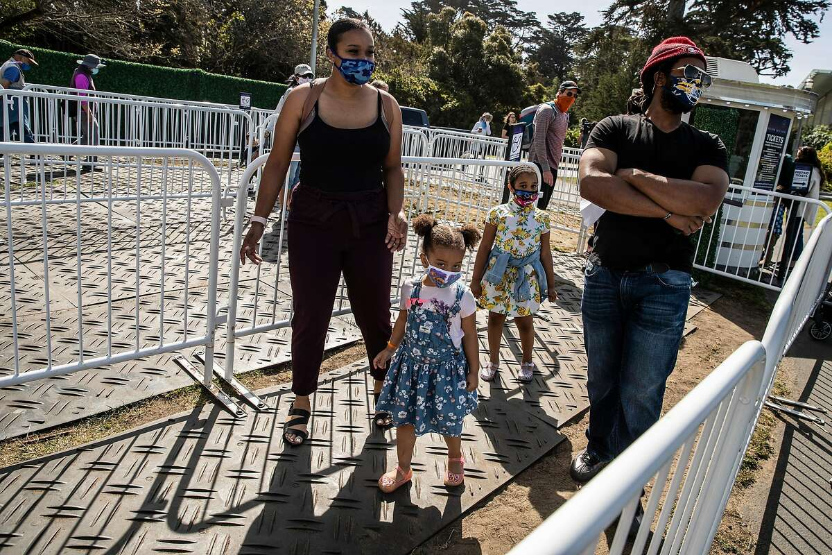 Antoine Mabrey (right), wife Alisha and daughters Ari and Amaya wait to ride the Skystar Observation Wheel on Mother's Day in Golden Gate Park.