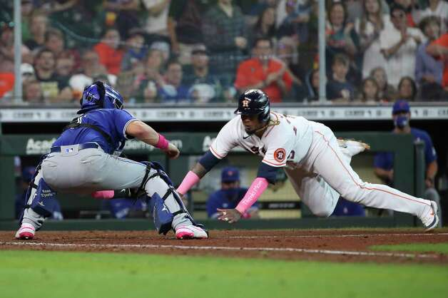 Toronto Blue Jays catcher Reese McGuire (7) tags out Houston Astros catcher Martin Maldonado (15) at home during the fifth inning of an MLB game Sunday, May 9, 2021, at Minute Maid Park in Houston. Photo: Jon Shapley, Staff Photographer / © 2021 Houston Chronicle