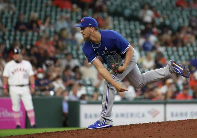 Toronto Blue Jays relief pitcher A. J. Cole (36) pitches  during the seventh inning of an MLB game Sunday, May 9, 2021, at Minute Maid Park in Houston. Photo: Jon Shapley, Staff Photographer / © 2021 Houston Chronicle