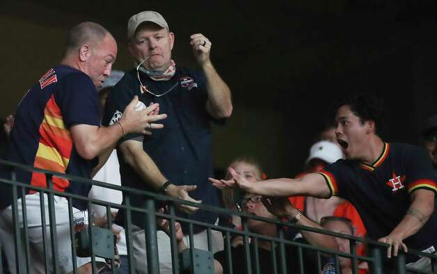 A fan catches a foul ball during the seventh inning of an MLB game Sunday, May 9, 2021, at Minute Maid Park in Houston. Photo: Jon Shapley, Staff Photographer / © 2021 Houston Chronicle