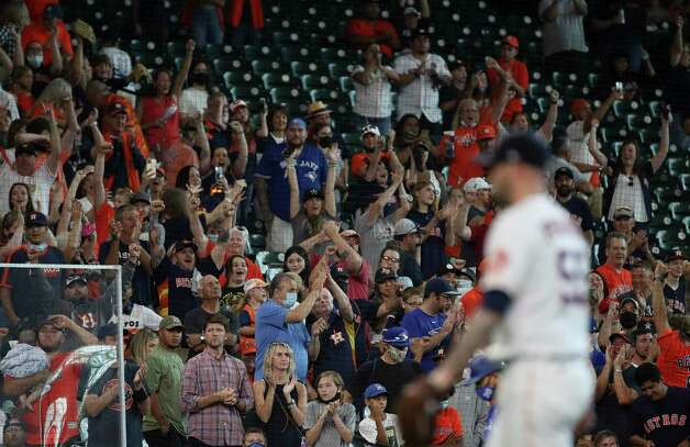 Fans cheer after the Houston Astros beat the Toronto Blue Jays on Sunday, May 9, 2021, at Minute Maid Park in Houston. Photo: Jon Shapley, Staff Photographer / © 2021 Houston Chronicle