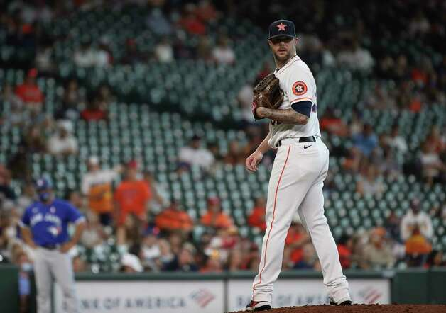 Houston Astros relief pitcher Ryan Pressly (55) checks first during the ninth inning of an MLB game Sunday, May 9, 2021, at Minute Maid Park in Houston. Photo: Jon Shapley, Staff Photographer / © 2021 Houston Chronicle
