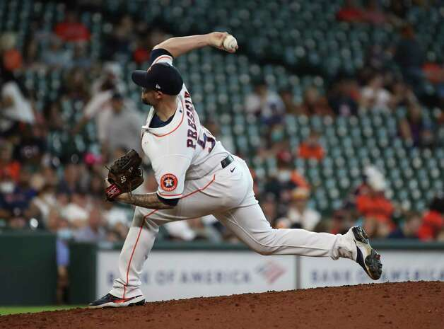Houston Astros relief pitcher Ryan Pressly (55) pitches during the ninth inning of an MLB game Sunday, May 9, 2021, at Minute Maid Park in Houston. Photo: Jon Shapley, Staff Photographer / © 2021 Houston Chronicle