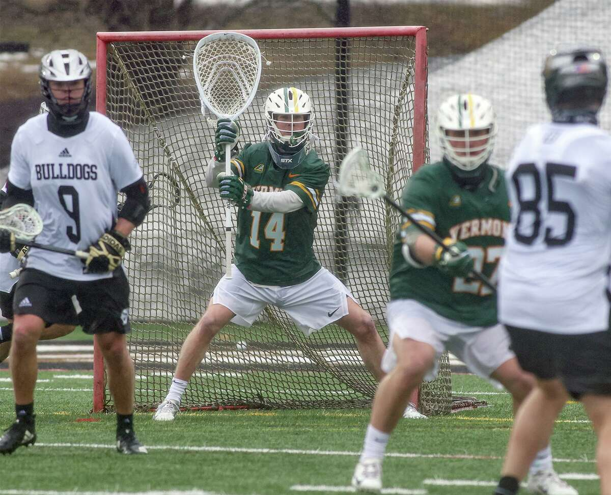 Vermont goalie Ryan Cornell (14) of Darien in action for the Catamounts during a men's lacrosse game against Bryant University on Feb. 27, 2021.