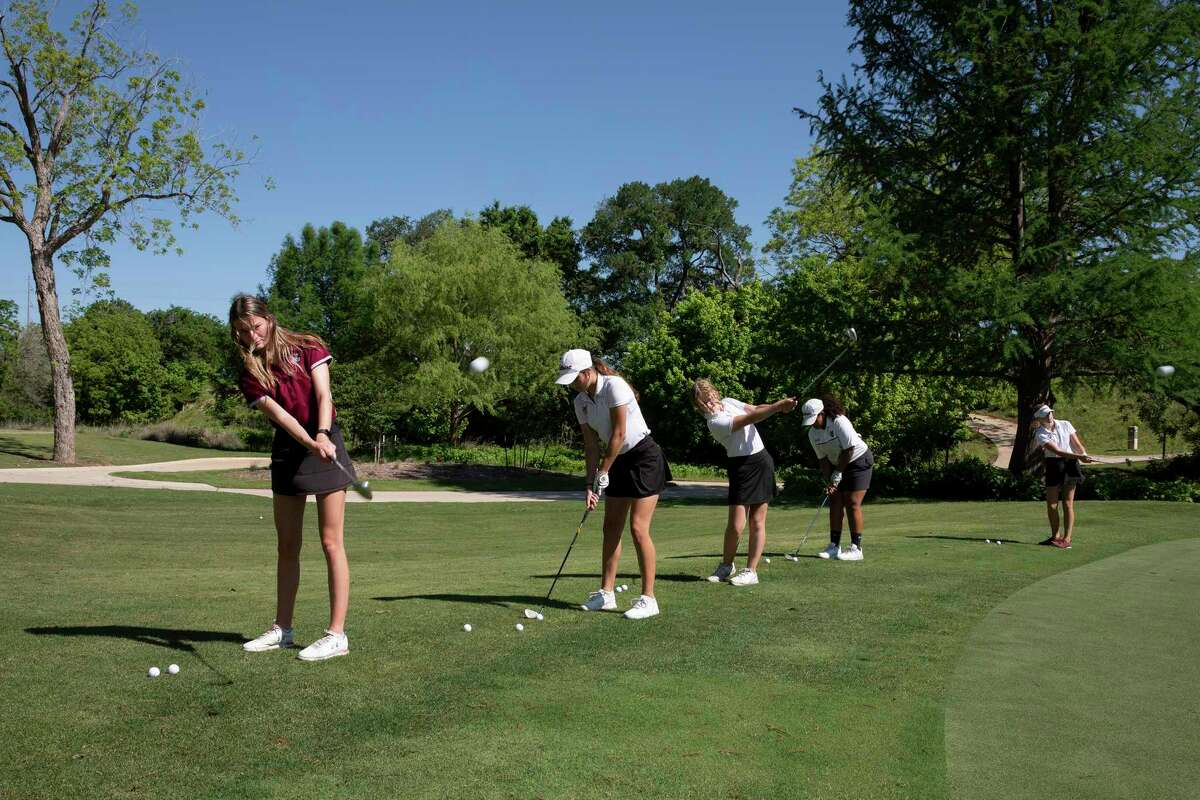 The Davenport girls golf team warm up before beginning practice in New Braunfels. This is the first year the school has had a golf team, and the girls team has qualified for the state tournament.
