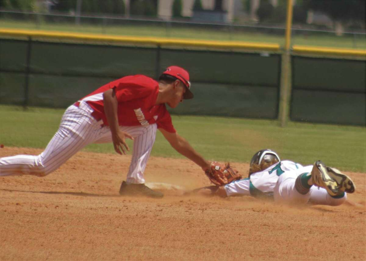 Memorial's Kaden Fernandez is tagged out at second base after he was picked off first base. Fernandez was never retired at the plate, walking three times and getting hit by a pitch. He scored two of the team's three runs.