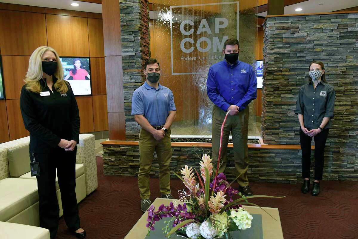 CAP COM employees, from left, Nicolle Monast, Jack Ainsley, Graig Furlong, Theresa Trietiak at CAP COM Federal Credit Union's headquarters on Thursday, April 22, 2021 in Albany, N.Y. CAP COM is one of the 2021 Top Workplaces. (Lori Van Buren/Times Union)