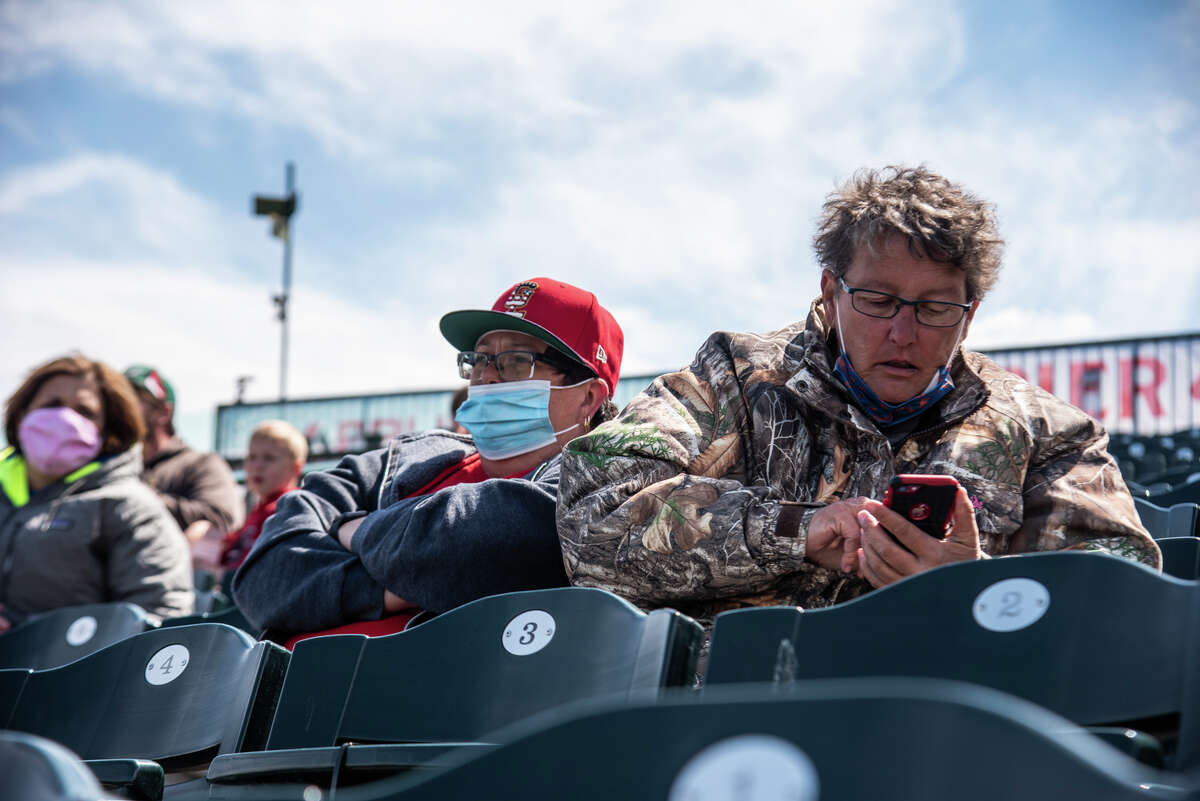 Fans watch as the Great Lakes Loons face off against the Dayton Dragons Sunday, May 9, 2021 at Dow Diamond in Midland. (Isaac Ritchey/for the Daily News)