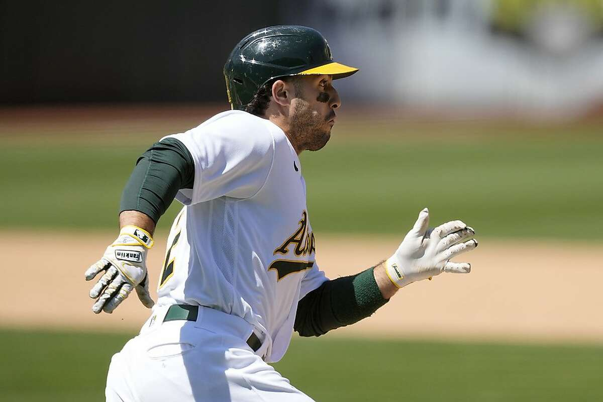 Oakland Athletics' Ramon Laureano rounds first base on his hit against the Toronto Blue Jays during the fifth inning of a baseball game in Oakland, Calif., on Thursday, May 6, 2021. (AP Photo/Tony Avelar)