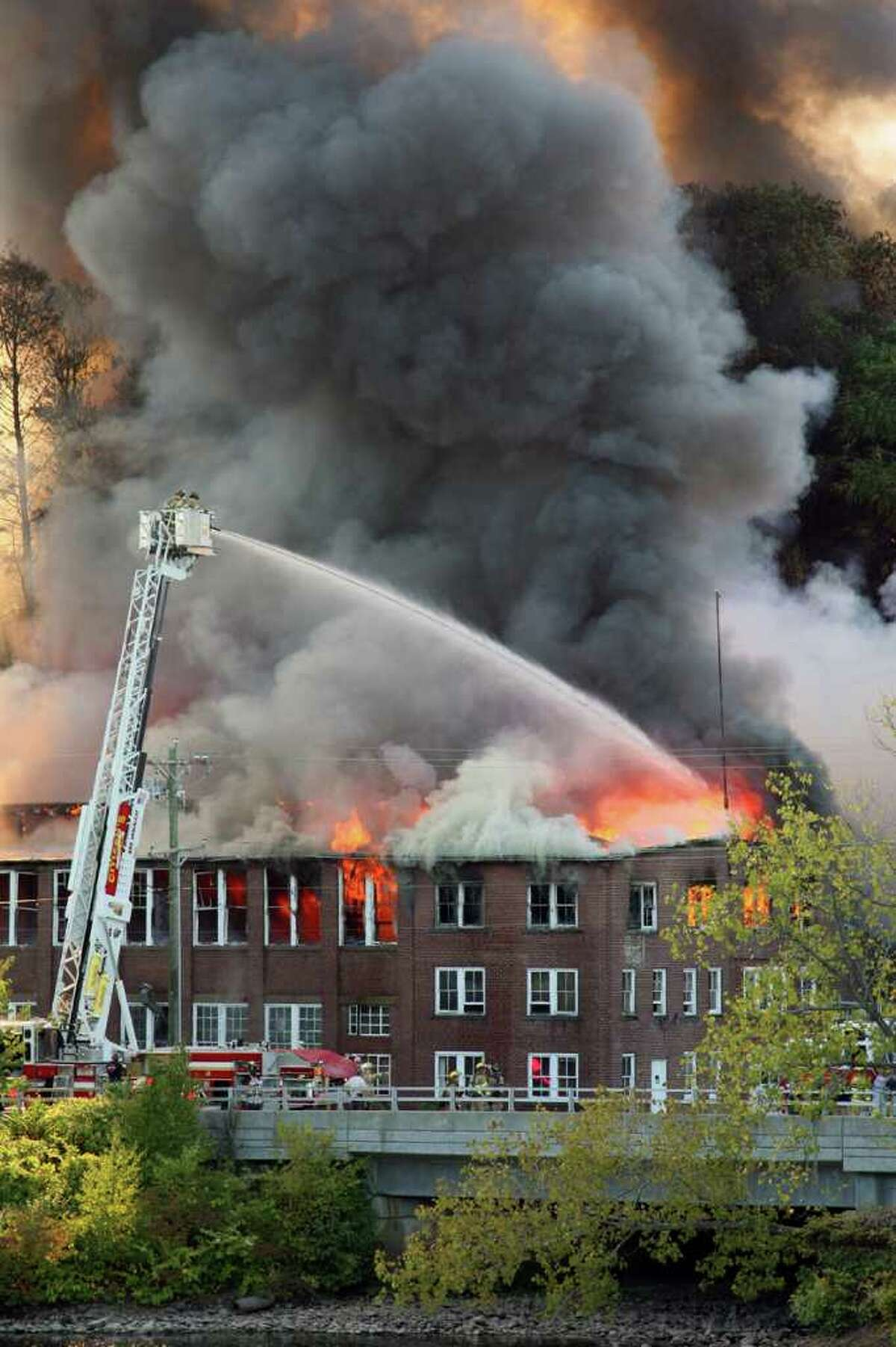 A raging fire ravaged the vacant Housatonic Wire factory complex on River Street. Sept. 11, 2010 Fire destroys the Housatonic Wire complex in Seymour. The building was slated to be the site of a new development. Read more.