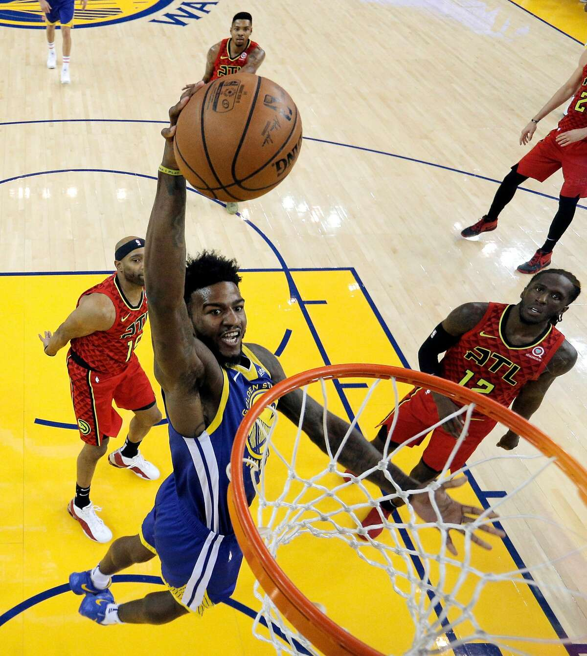 Jordan Bell (2) goes in for a dunk in the first half as the Golden State Warriors played the Atlanta Hawks at Oracle Arena in Oakland, Calif., on Tuesday, November 13, 2018.