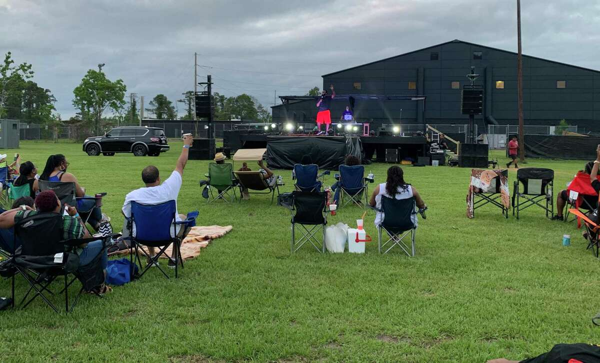 Marcus Wiley (on stage) addressing the crowd before the Jus Jokin' Outdoor Comedy Series show on Saturday, May 8, 2021 in Beaumont, TX.