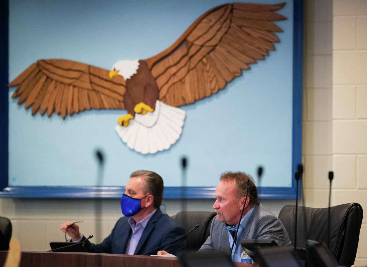 Barbers Hill board chairman George Barrera, left, and superintendent Greg Poole attend a board meeting in Mont Belvieu. With 34 active Chapter 313 projects in Barbers Hill, no other school district in Texas has approved more deals.