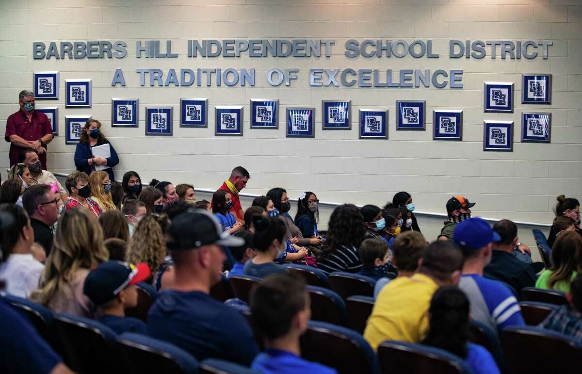 Barbers Hill Independent School District students and their parents gather to attend a Barbers Hill ISD board meeting, Monday, April 26, 2021, in Mont Belvieu.