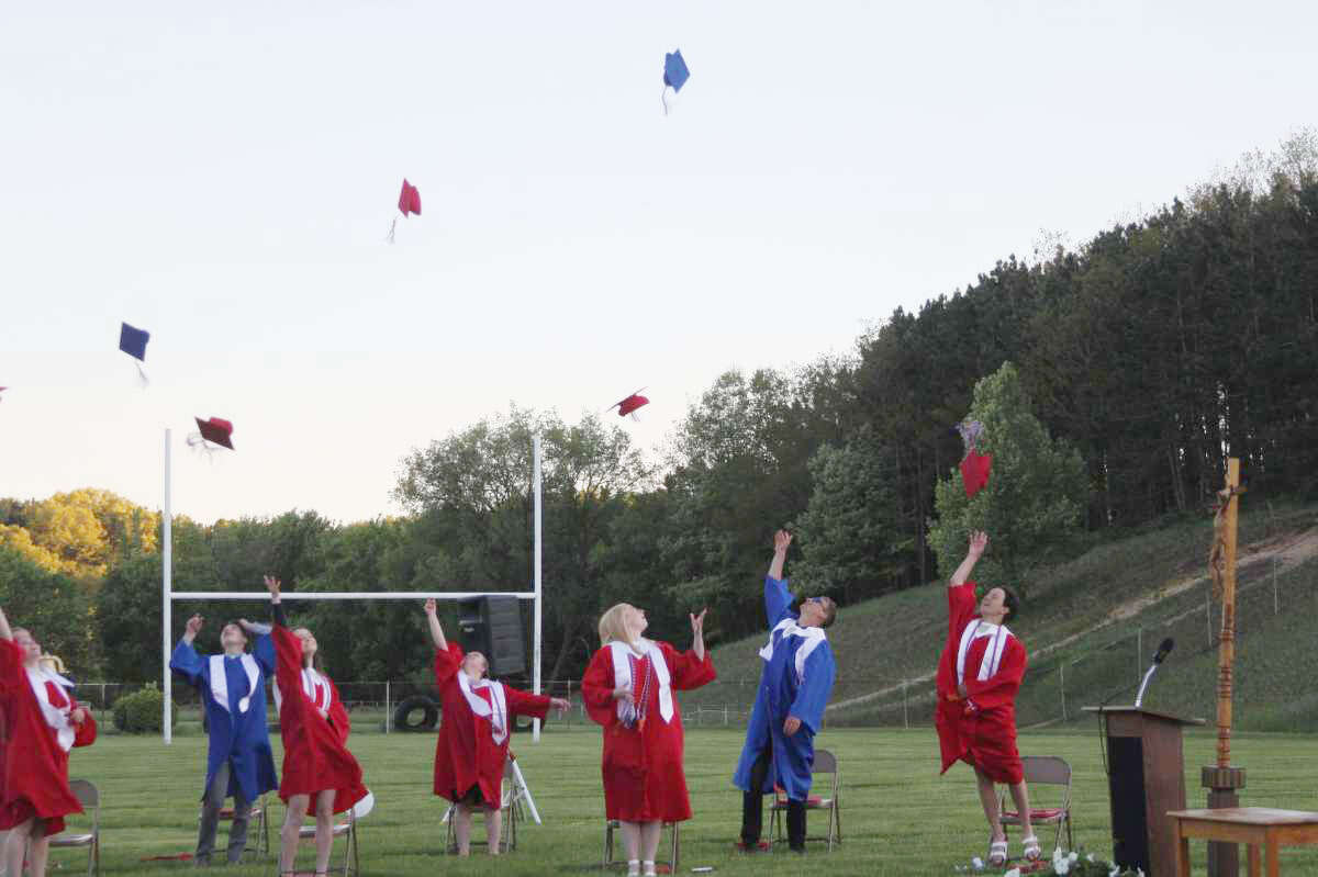 In this file photo, Manistee Catholic Central's class of 2020 throws their caps in the air during Manistee County's only non-virtual commencement ceremony last spring. This year, all Manistee County schools are preparing to hold in-person ceremonies.