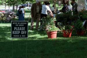 "The Farmer's Market in New Milford, had its opening day, on Saturday May 14, this sign, to"" keep off the grass"", is alsoon the green in New Milford,"