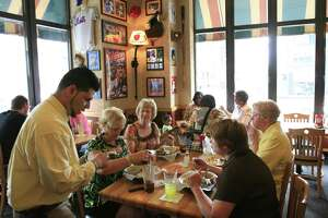 In a file photo, customers enjoy lunch at an Applebee's Neighborhood Grill & Bar in New York.