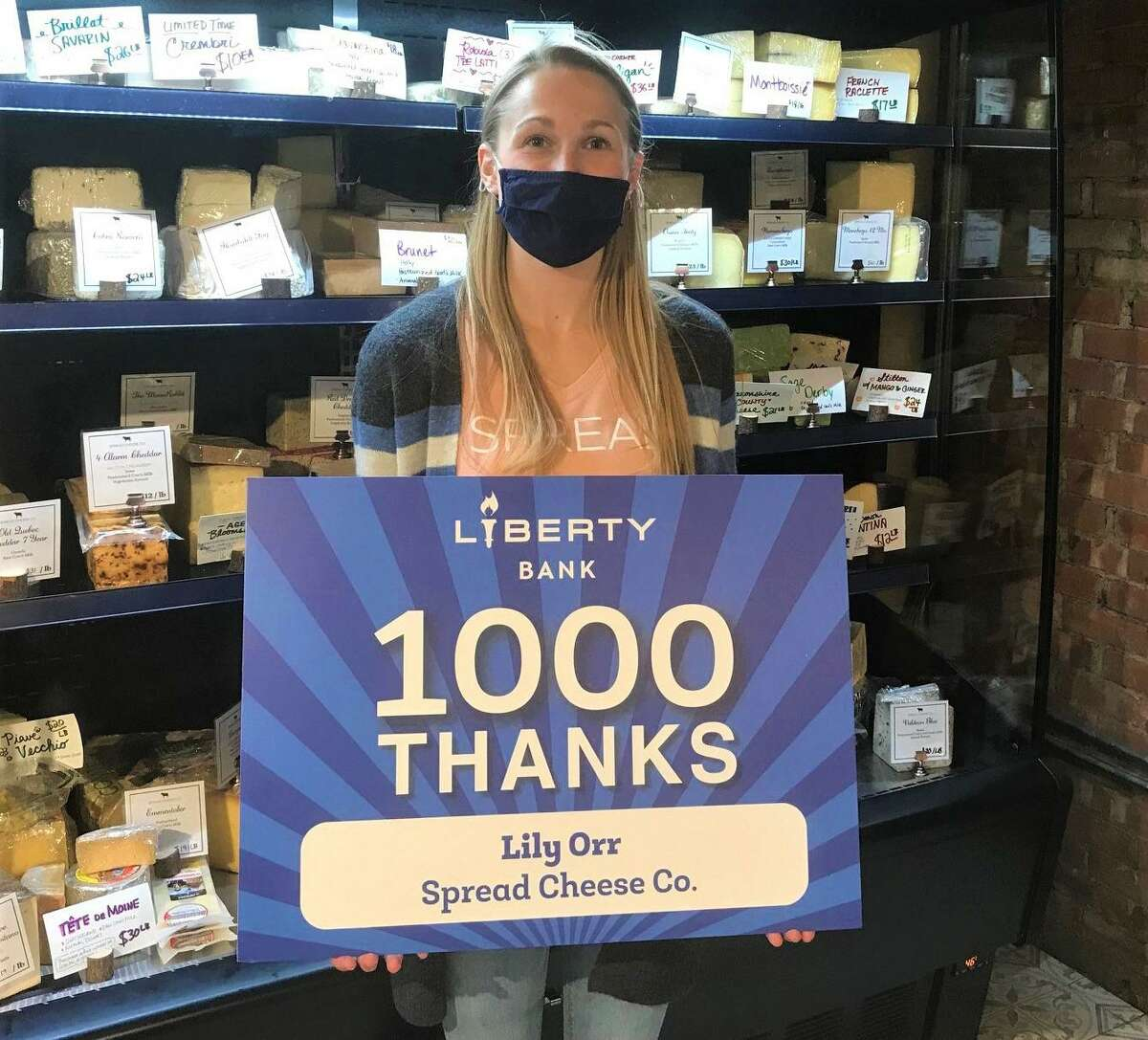 Middletown-based Liberty Bank's 1,000 Thanks Campaign recognizes small business partners and teammates who help them succeed. Lily Orr, of Spread Cheese Co., at Middletown's Main Street Market, was among those honored.