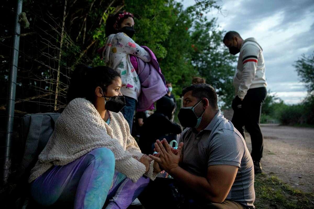 Luis Aldana comforts his wife, Maria Fernanda Coronado, who is pregnant. The couple and their daughter, Maria Davalillo, crossed the Rio Grande near Del Rio.
