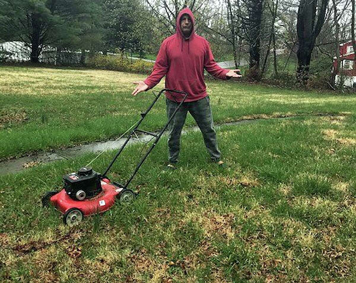 Vinnie Penn gets ready for the first mow of the season. He seems to look less than enthuasitic.