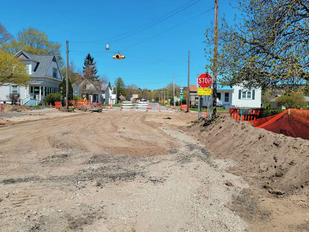 The intersection of M-22 and Crystal Avenue, where the road has been demolished and the City of Frankfort is installing new water infrastructure and sidewalks before MDOT rebuilds the road. (Colin Merry/Record Patriot)