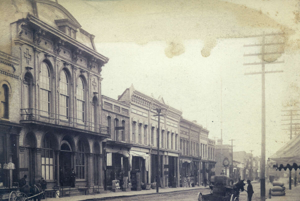 A view of the former Women's Temperance Association Hall which became occupied by the Olympian Club in 1888. The building is pictured in the far left of the photograph.