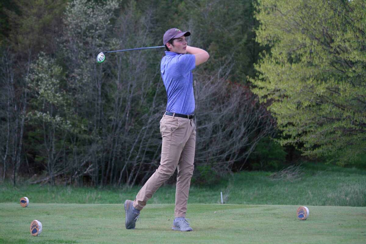 Adam Mills follows his drive during a Northwest Conference golf match on May 6. (Robert Myers/Record Patriot)
