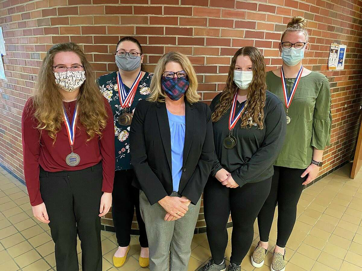 Pictured from left are Alma College BPA members Allison Harbaugh, Samantha Courtright, faculty advisor Tina Rolling, Madeline Kugler and Brianna Sharpsteen. Not pictured is Kasidey Easlick. (Photo Provided)