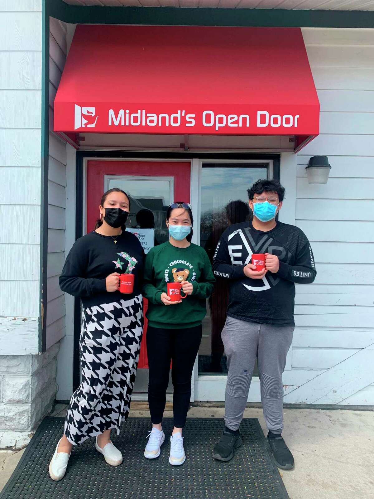 Dow High sophomores, from left, Maia Figueroa, Corrine Cai, and Jacob Nguyen stopped by the Open Door for an official tour recently. (Photo Provided)