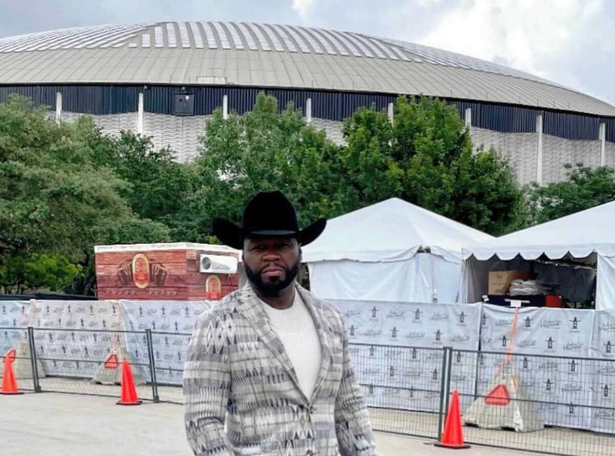 Rapper 50 Cent poses in front of the NRG Center in Houston.