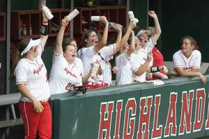 The Woodlands softball team reacts in the dugout after gaining a 15-run lead during the second inning of a Region II-6A bi-district playoff game against Dekaney at The Woodlands High School, Thursday, April 29, 2021, in The Woodlands.