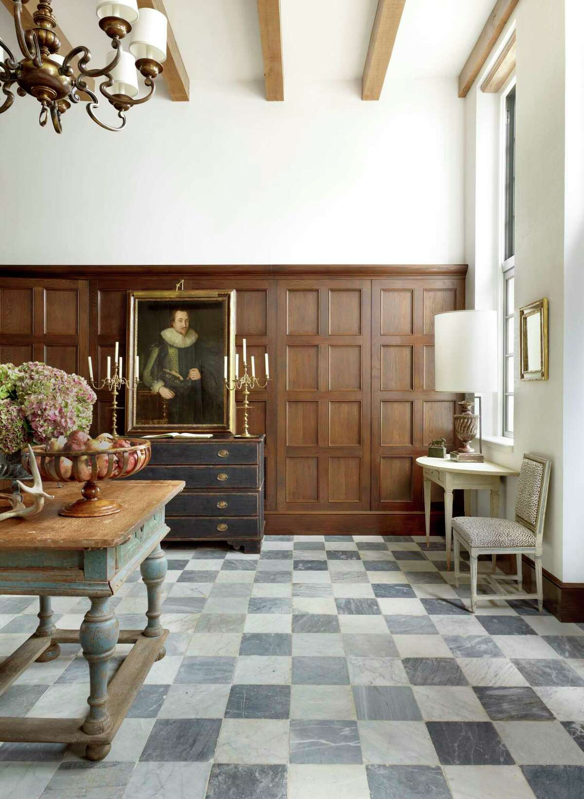 Designer Bobby McAlpine's says clients are looking for something different; they don't want their homes to look like everything else on social media. Painted floors and antiques set apart this room featured in his book,