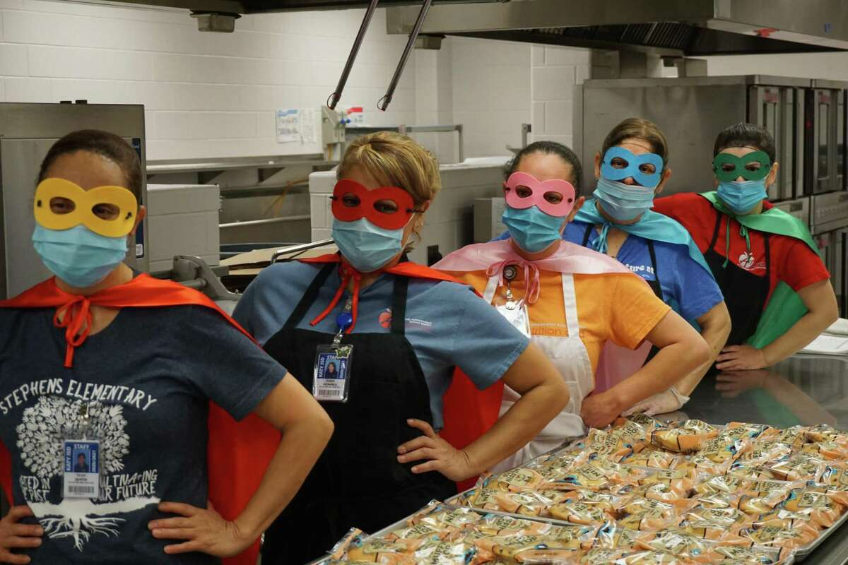 Kitchen staff members at Ursula Stephens Elementary in Katy wear capes and eye masks as they are recognized for National School Lunch Hero Day on Friday, May 7.