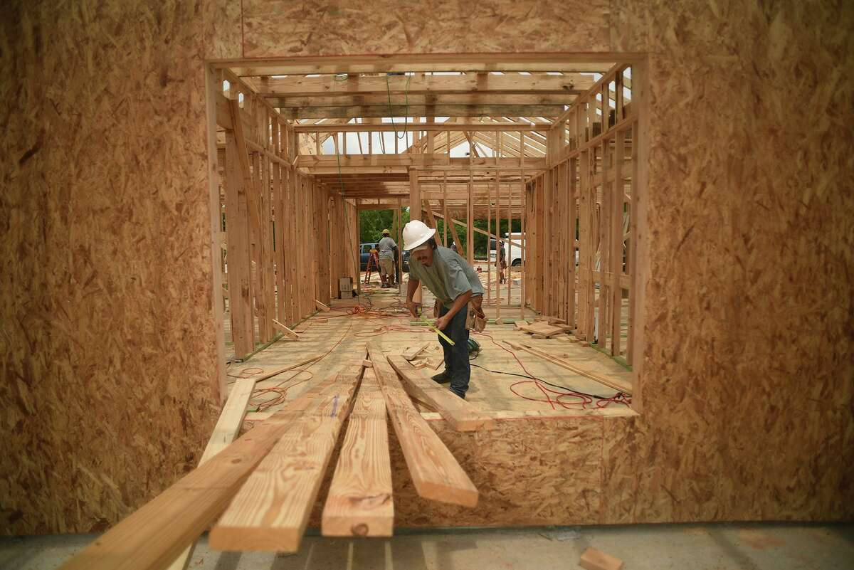 An LGI Homes crew works on a new home on Nina Road in the Chase Run community in Conroe on May 12, 2016.