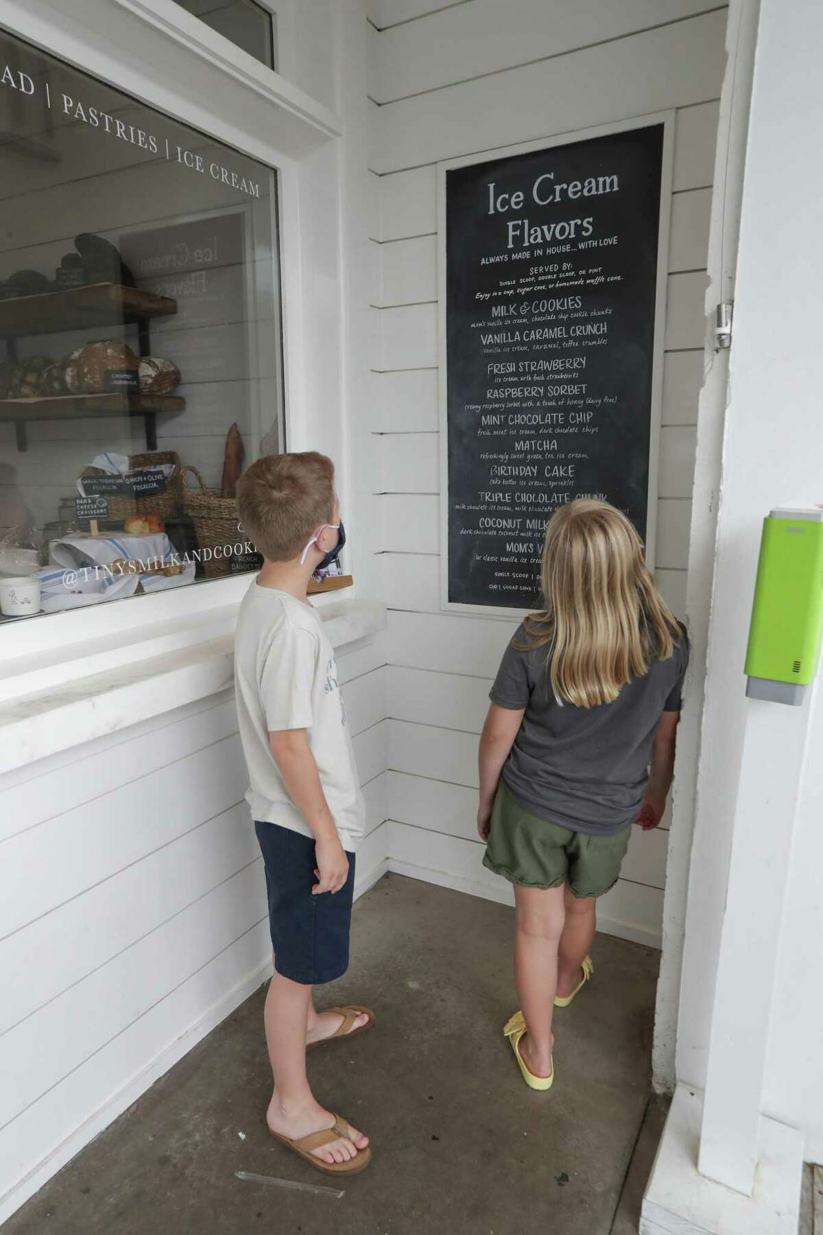 Jace Sonnier, 12, and his sister Jordyn, 10, look at the ice cream menu Saturday, May 8, 2021, in Houston.