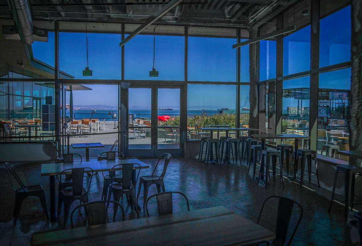 Harmonic Brewing's new Thrive City taproom near the Chase Center features floor-to-ceiling windows overlooking the bay in San Francisco.