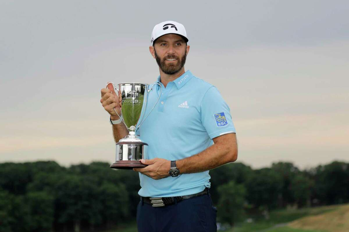 Dustin Johnson poses with the trophy after winning the Travelers Championship golf tournament at TPC River Highlands, Sunday, June 28, 2020, in Cromwell, Conn. (AP Photo/Frank Franklin II)