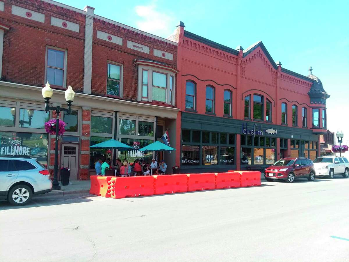"""This July 2, 2020 file photo showsa portion of River Street in downtown Manistee. """"Building a vibrant downtown district is an essential ingredient in retaining your youthful souls, who often leave, never to return,"""" according to columnist John Newby. (File photo)"""