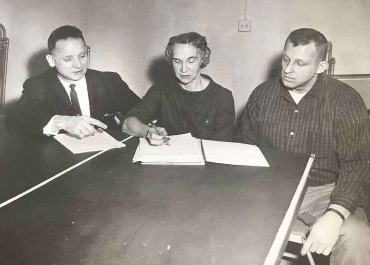 New officers of the Midland Downtown Business Association are, from left, Marvin Stein, president, Geraldine Yates, secretary, and Walter Wenzel, treasurer. Benjamin Hines, vice-president, is not pictured. February 1964