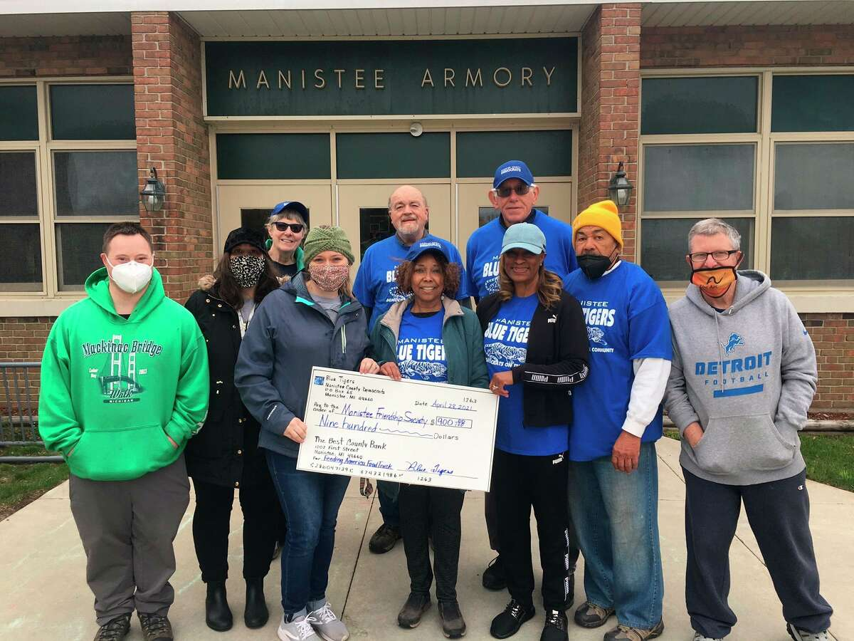 Members of the Blue Tigers, the community outreach organization of the Manistee County Democrats, presented a donation for $900 to the Manistee Friendship Society on April 28 at the Armory Youth Project in Manistee. (Courtesy photo)