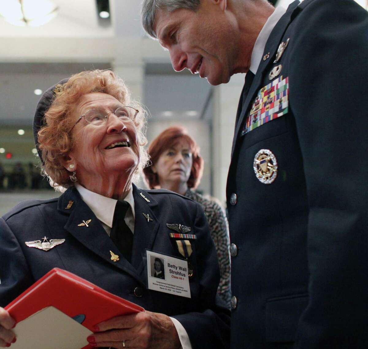 In this March 10, 2010 file photo, Air Force Chief of Staff Gen. Norton Schwartz greets Elizabeth Strohfus of Faribault, Minn., on Capitol Hill in Washington, before she and other members of the Women Airforce Service Pilots were awarded the Congressional Gold Medal.