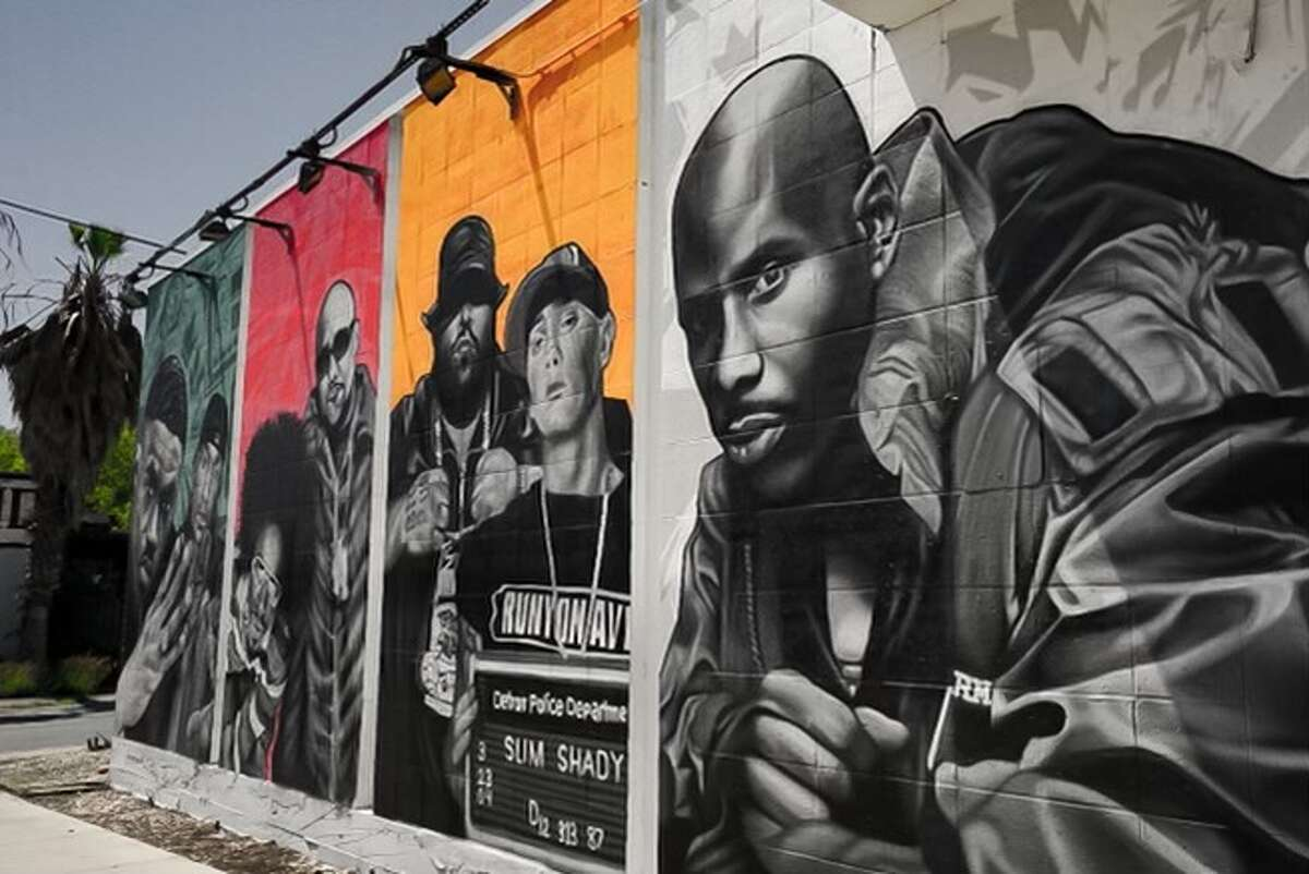Smack's Chicken Shack owner Keenan Hendricks tapped local muralist Mike Comp to complete a mural at the restaurant honoring rap legends.